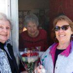 Club women presenting 50 year member pin